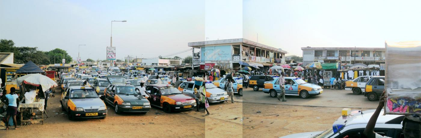 "Tema Market in Community 1, taxis and small shops invade the ""sidewalk"""